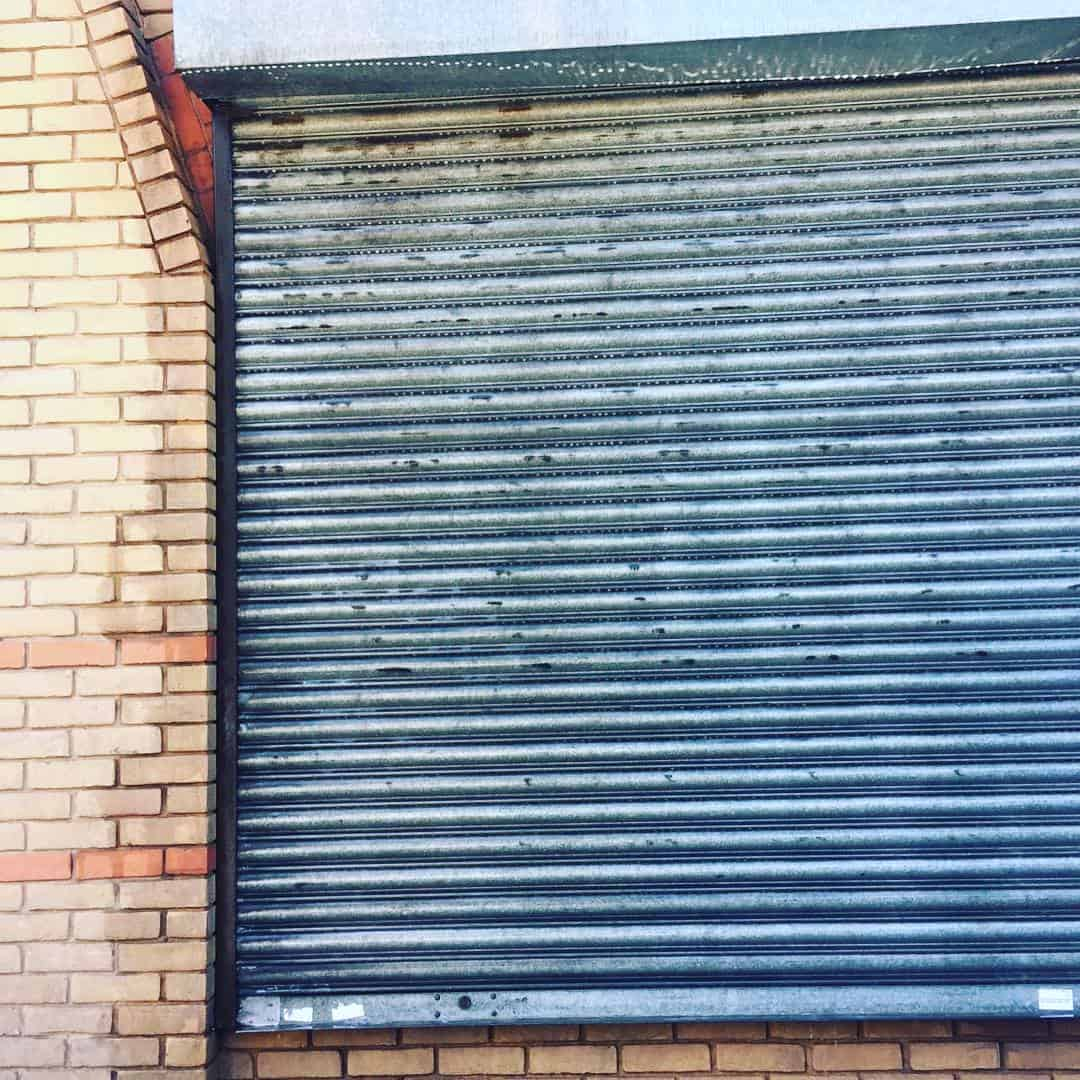 Graffiti removal from shop shutters