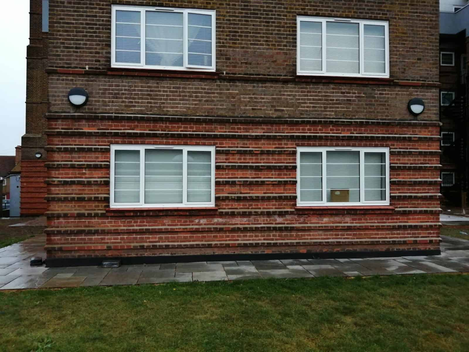 Remove black stains from brickwork